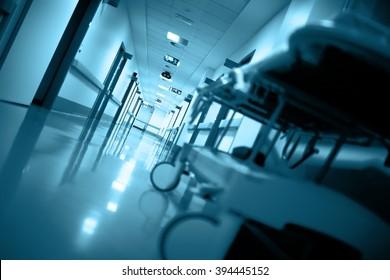 Empty gurney in a long corridor.