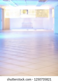 Empty hall in bokeh background. Room is backlit by blue light. Useful for photomontage