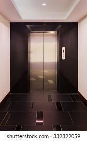 Empty hall of business building having elevator.