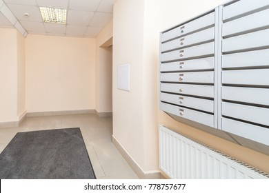 Empty hall mailboxes and doors at new apartment building