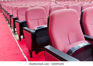 Empty hall for presentation with red armchairs