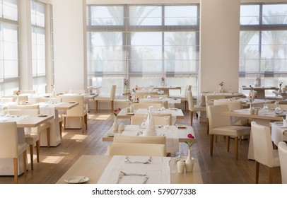 Empty hall of the restaurant, with tables ready for the lunch