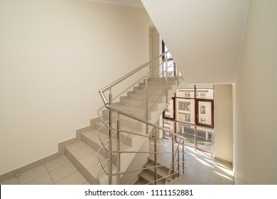 Empty hall with stairs office building interior