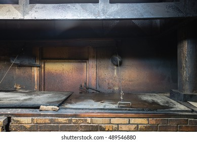 Empty hallowed pit room at a traditional Texas style BBQ Meat Market. Smoke house with indirect-heat pit and gas-fired smoker. Old fashioned slow cooked chop in family meat market, La Grange, TX, US