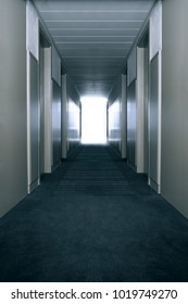 Empty hallway with bright window