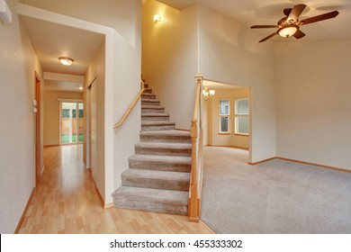 Empty hallway interior with carpet stairs view. Also hardwood and carpet floor