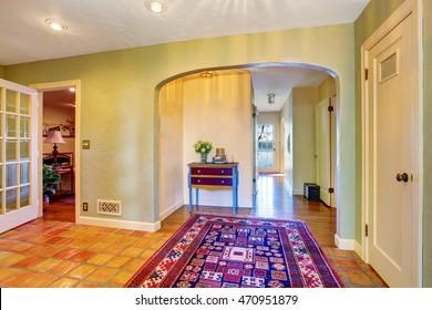 Empty hallway interior with green walls and rug. Northwest, USA