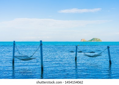 Empty hammock around beautiful beach sea ocean for relax in holiday vacation travel concept