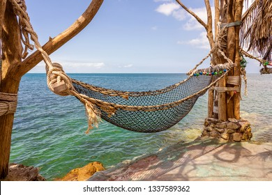 Empty hammock on beautiful tropical beach near blue sea water, Thailand, closeup. Summer concept. Holiday travel.