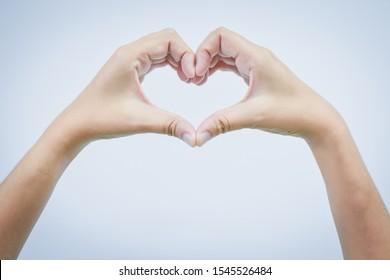 Empty hand making heart shape isolated on white background