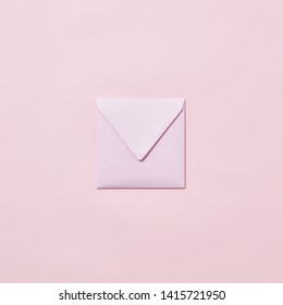 Empty handmade envelope for congratulation card on a light pink background with copy space. Mockup.