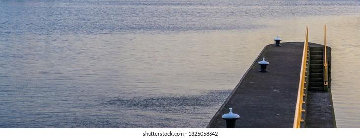 empty harbor, water embankment in Alphen aan den rijn, The Netherlands