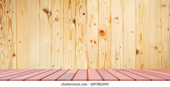 Empty hardwood table top in front of raintree wooden wall background