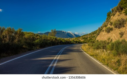 empty highland car road in mountains fresh calm natural summer bright and blossom environment