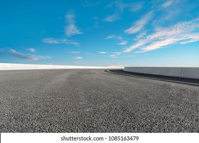 Empty highway asphalt road and beautiful sky landscape