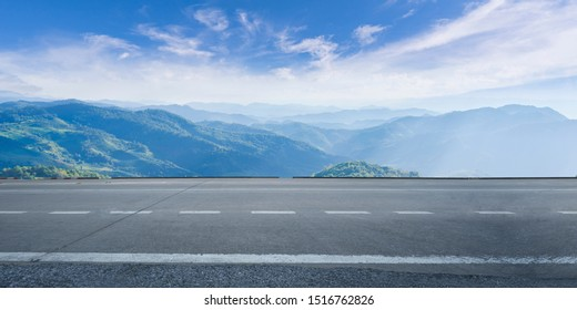 Empty highway asphalt road and beautiful sky mountain landscape