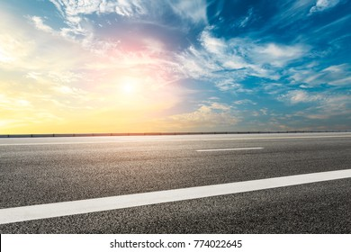 Empty highway asphalt road and beautiful sky sunset landscape