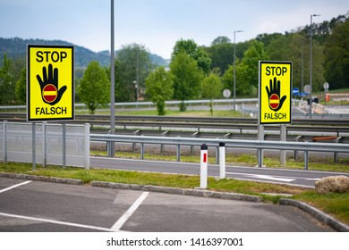 Empty highway in the austrian countryside with the STOP/ FALSCH (stop / false) sign to warn the drivers