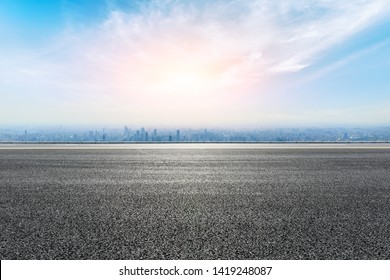 Empty highway road and modern city skyline in Shanghai,China