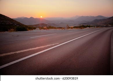 Empty highway. Highway at sunset. Road. Beautiful sun rising sky with asphalt highways road in rural scene
