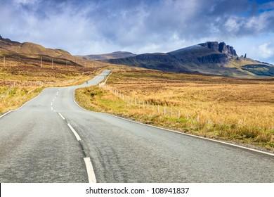 Empty highway through a desolate landscape in Scotland