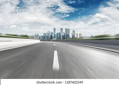 empty highway through modern city