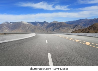 Empty highways and distant mountains,Tibet,china