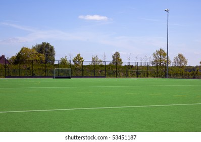 a empty hockeyfield with blue sky