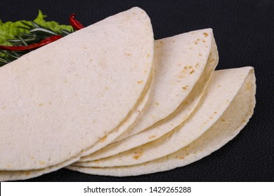 Empty homamade tortilla served salad leaves