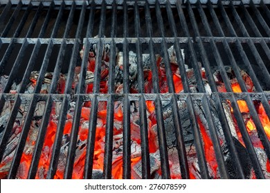 Empty Hot Barbecue Cast Iron Grill With Glowing Charcoal Background