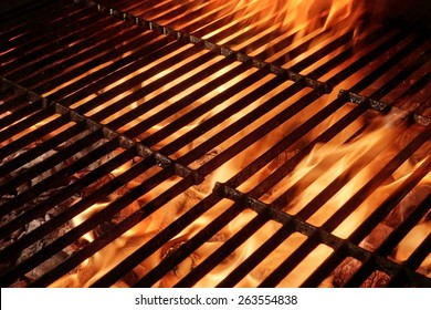 Empty Hot Barbecue Grill With Flames and Copy Space. Picnic or Party or Cookout Background. You can see more Flaming Grill in my set.