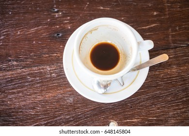 Empty hot coffee cup after drink on wood table