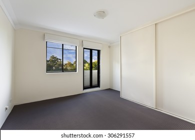 Empty house interior. Spacious family room with clean carpet floor