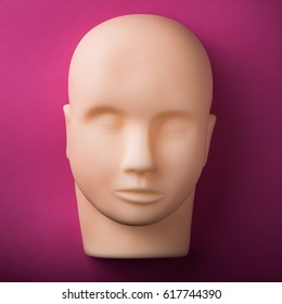 empty human dummy head with realistic skin on texture. top view