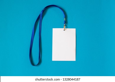 Empty ID card badge icon with blue belt, on blue background. Space for text,  staff identity name tag template.
