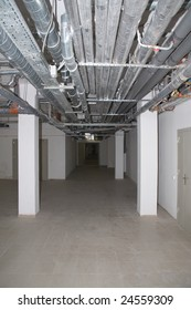 empty illuminated basement with pipelines