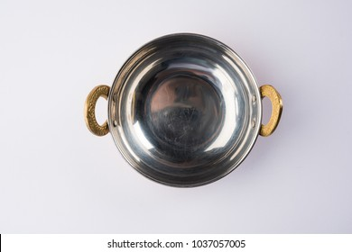 empty Indian Kadhai or Karhai or frying pan or iron wok isolated on white background