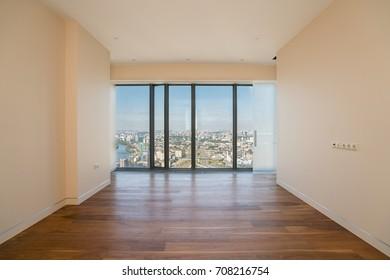 Empty  interior apartament with panoramic city view.