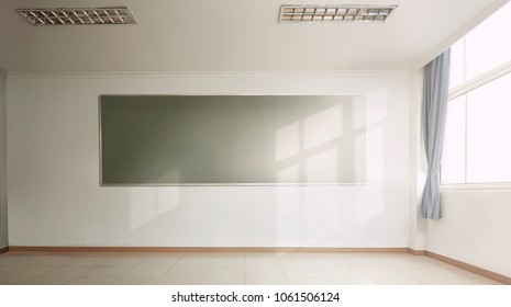 Empty interior of classic school classroom with green Chalk board on the Wall