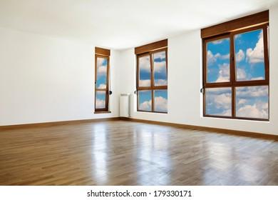 Empty interior room and three windows