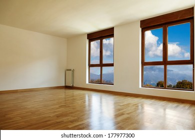 Empty interior room and two windows closed
