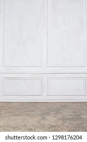 Empty interior with white wall panels and concrete floor
