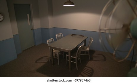 EMPTY INTERROGATION ROOM.  High, wide angle.  Fan in foreground.  PROPERTY RELEASE ATTACHED. Shot with permission at Northlight's Underground Studios in Glendale, CA.