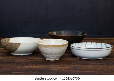 Empty Japanese  ceramic bowl on wooden table.