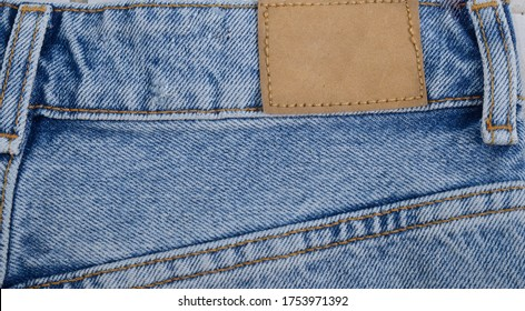 Empty jeans back pocket of classic blue denim pants. Simple blue jeans back side view, plain blank pocket, close up