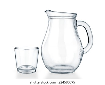 Empty jug and glass on a white background.