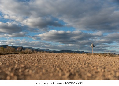 Empty Karoo landscape with a gravel road leading into the distance