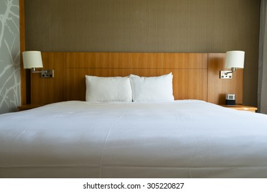 Empty king-size bed in hotel.