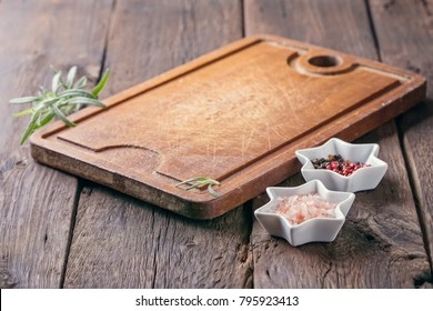 Empty kitchen board and spices