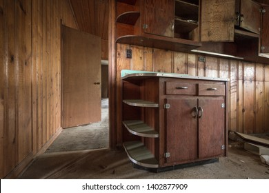 Empty kitchen cabinets left forgotten in an old abandoned home in a rural area